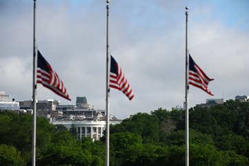 With the White House in the background, U.S. flags fly at half-staff on the National Mall to commemorate the victims of the coronavirus disease (COVID-19) in Washington
