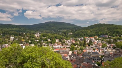 Fototapete - Timelapse - Moving clouds over Taunus low mountain range as seen from castle Koenigstein, Hesse, Germany