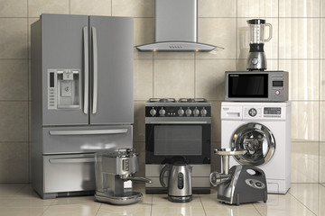 Set of home kitchen appliances on the wall background. Household kitchen technics.