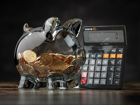 Savings, investment, credit calculator and accounting financial concept. Piggybank with calculator.