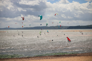 Windsurfers at Exmouth beach in Devon