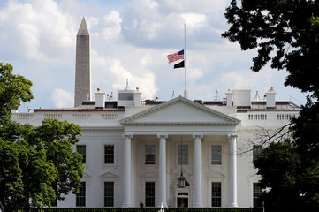 Flags fly at half-staff on the White House to commemorate the victims of the coronavirus disease (COVID-19) in Washington