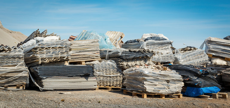 Asbestos landfill . Roof covering material with asbestos fiber . Asbestos roof removal . Dangerous asbestos dust and fiber in the environment . Health problems