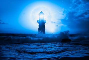 Wall Mural - Night sky with lighthouse, in the background amazing blue moon in the clouds