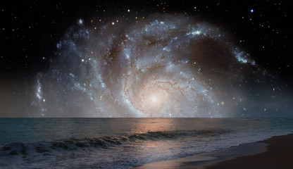 Wall Mural - Galaxy over the sea with sunset reflection on the sea