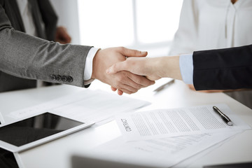 Business people shaking hands finishing contract signing, close-up. Business communication concept....