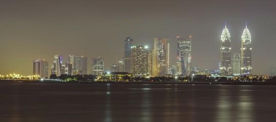 Canvas Prints New York Sea By Illuminated Modern Buildings Against Sky