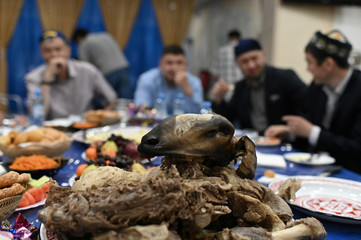 Traditional dishes are seen on a table as Muslim clerics share a meal after prayers during Eid al-Fitr, a Muslim festival marking the end the holy fasting month of Ramadan, at a mosque in Omsk