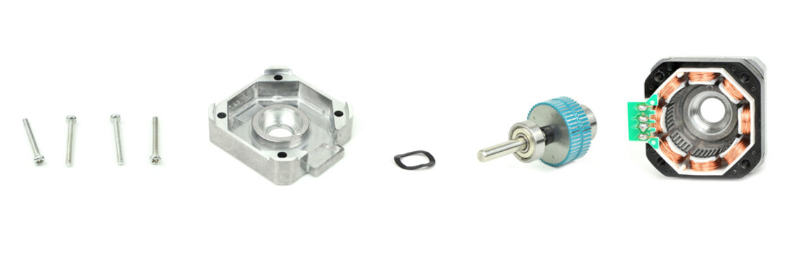 Deconstructed parts of electrical stepping or stepper motor isolated on white background with clipping path. NEMA standard flange motor for driving axes of CNC machines.