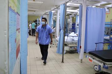 Muslim doctor Muhammad Syahidd Al Hatim works at Emergency Department in the Kuala Lumpur Hospital, during the last day of Ramadan, amid the coronavirus disease (COVID-19) outbreak, in Kuala Lumpur