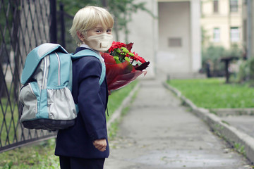 Schoolboy in protective mask outdoors. Back to school concept