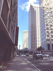 Fotobehang Vehicles On Road Amidst Modern Buildings