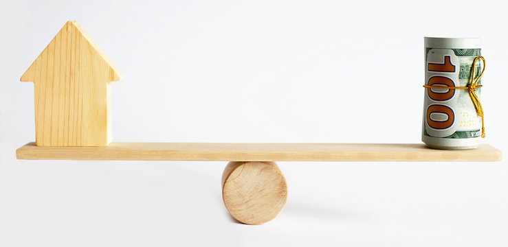 Seesaw Showing Balance Between money And House Model