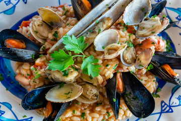Seafood risotto  in Positano restaurant, Italy.
