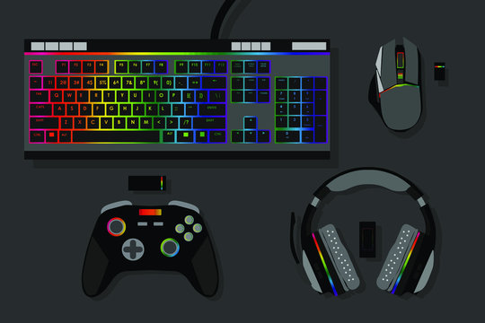 gamer workspace concept, top view a gaming gear, mouse, keyboard, joystick, headset, mobile joystick, in ear headphone and mouse pad on black table background with copy space.