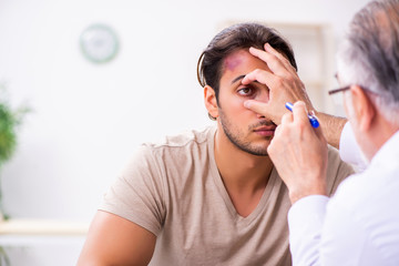 Young face injured man visiting experienced male doctor traumato