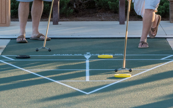 A game of shuffleboard in progress, an outdoor activity especially popular in senior communities