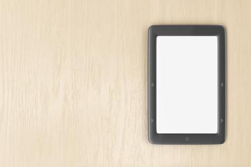 E-book reader on wood desk