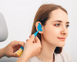 Personally molded earplugs. Process of making earplug from an impression of an individual s woman...