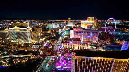 Fotobehang Las Vegas aerial panorama of Las Vegas Strip by night. Scenic flight over High Roller, Caesars Palace, The Paris, Planet Hollywood, Bellagio Casino and Hotel