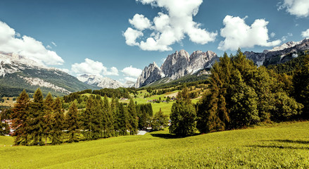 Fotomurales - Wonderful Alpine valley of sunny day. Dolomites mountains in summer. beautiful autumn landscape with majestic mountain peak on background