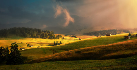 Fotomurales - Fantastic foggy morning over Alpe di Siusi during sunset. Awesome Alpine landscape with traditional huts. Amazing Nature Scenery of Dolomites Alps. Beautiful landscape of mountains valley.