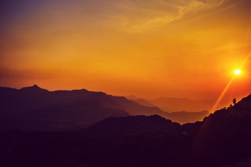 Scenic View Of Silhouette Mountains Against Dramatic Sky - fototapety na wymiar