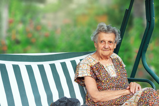 Portrait of a beautiful senior woman outddors. Place for text