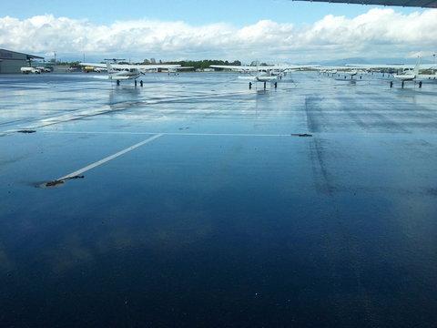 Airplanes At Wet Runway