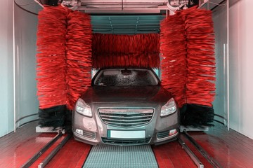 Car wash, clean foam service. Wax vehicle. Hand carwash with water and soap. Auto cleaner station. Automatic care, waxing.