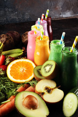 Multicolored smoothies and juices from vegetables, greens, fruits and berries, food background. Detox and dieting, clean eating, healthy lifestyle concept