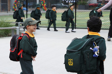 Children return to campus for the first day of New South Wales public schools fully re-opening in Sydney