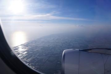 Fototapeta Aerial View Of Sea Seen Through Airplane Window obraz