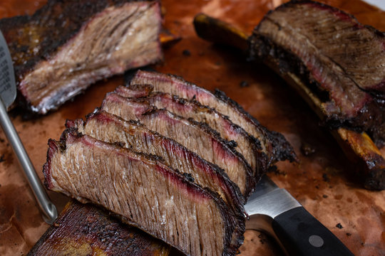 Smoked beef chuck short rib (official identification is NAMP 130), with one portion sliced and presented on the bone
