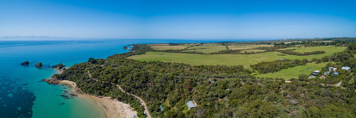 Aerial panoramic landscape of ocean and farmlands in Australia