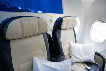 The interior of the aircraft. Empty airplane cabin. Seats for passengers in the business class...