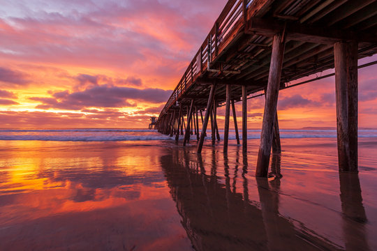 Dramatic, colorful sunset over a wooden beach pier. Imperial Beach, California, United states of America