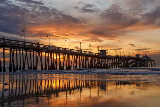 Brilliant sunset over a wooden beach pier. Imperial Beach, California, United states of America