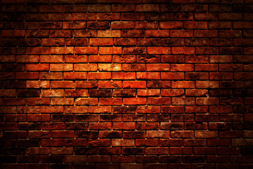 Empty space red brown vintage grunge brick wall texture background with light shading on wall.