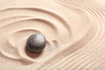 Photo sur Plexiglas Zen pierres a sable Stone on sand with lines. Zen concept