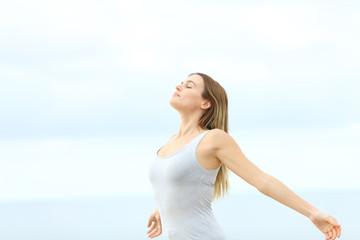 Woman breathing fresh air at the beach