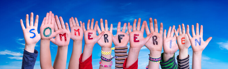 Children Hands Building Colorful German Word Sommerferien Means Summer Holdiays. Blue Sky As Background Fotomurales