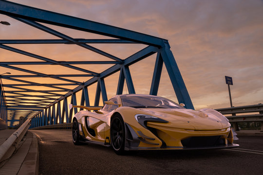 McLaren P1 GTR, McLaren racing hypercar on a truss bridge