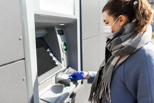 finance, bank and hygiene concept - woman in medical mask and glove with cash money at atm machine