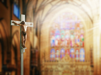 Crucifix, Jesus on the cross in church with ray of light from stained glass. 3d rendering