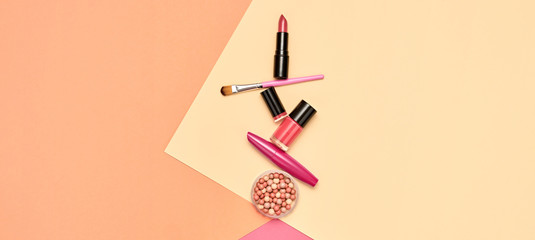Beauty cosmetic makeup set. Fashion woman make up product, brushes, lipstick, pop art flat lay. Creative vivid concept. Cosmetology make-up accessories on beige banner, top view