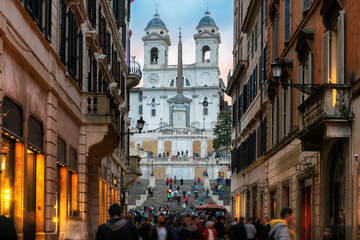 Old cozy street near Spanish Steps in evening in Rome, Italy.  Night cityscape of Rome.
