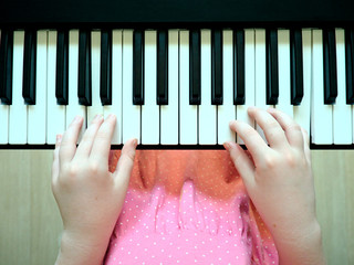 Closeup girl hands playing piano - Azimuthal perspective