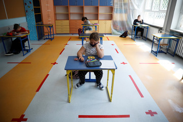 Children take part in a lesson after schools reopened in Warsaw