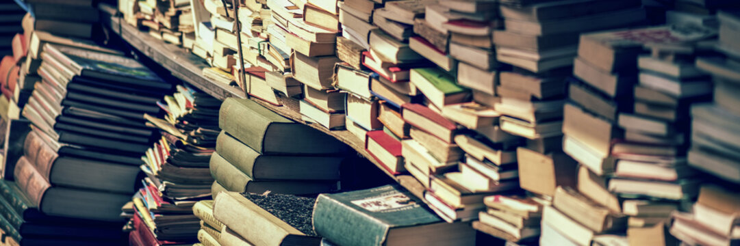 Stack of books at the bookshop banner